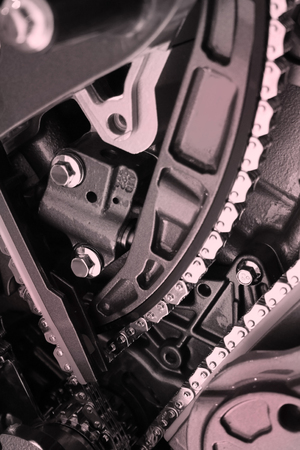 close up shot of engine showing belts and chains photo