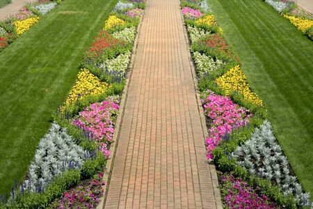 manicured: Walk way through lush green beautiful garden