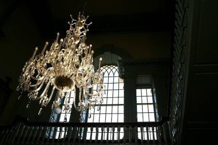 sun light falling on chandeliers in a historic building