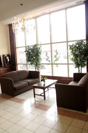 leasure: waiting area by window in elegent hotel lobby Stock Photo