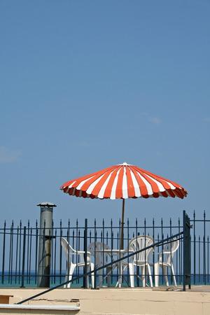 shady: Red and white beach umbrella in michigan
