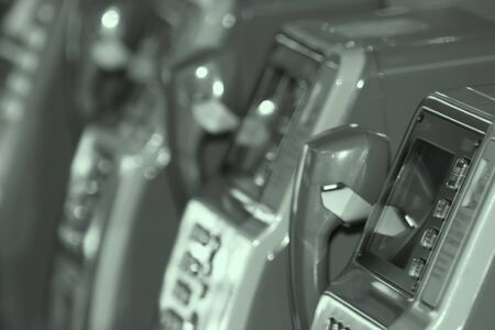 Close up shot of public telephones in monochrome