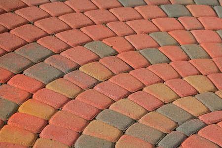 Patio bricks in semi circular pattern with warm color tone photo