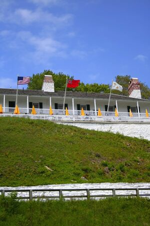 lowered: Mackinac fort on top of a hill diffeent country flags