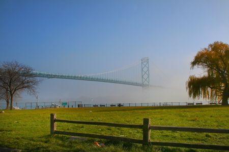 ambassador bridge caught in mist in michigan photo