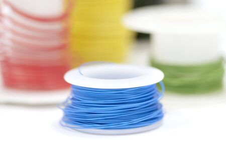 electric wires: Colorful wire rolls on white background close up shot Stock Photo