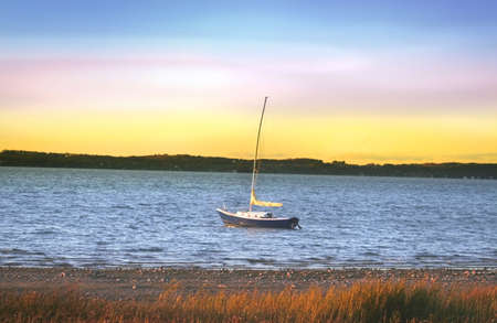huron: Single white boat in the lake during sunset time