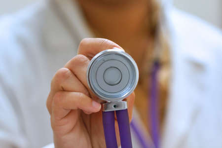 Doctor Holding Stethoscope photo