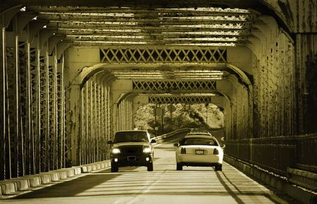 Two Cars Crossing A Bridge Stock Photo - 3207680
