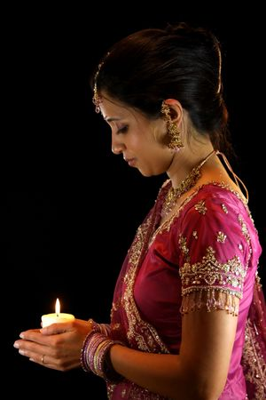 woman back of head: Indian Bride Holding Candle
