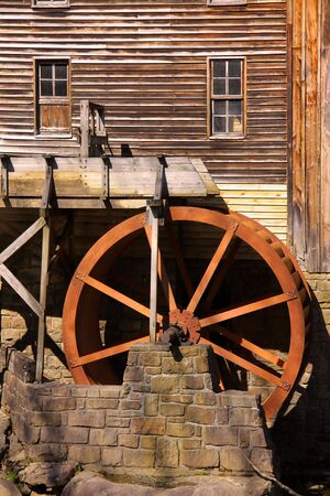 Rustic Wheel On Water Mill photo