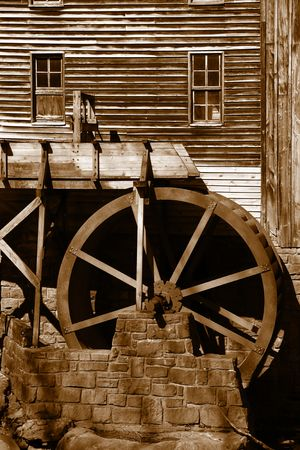 Rustic Wheel On Water Mill photo