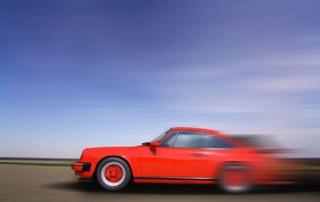 going: Red Sports Car in fast motion  Stock Photo