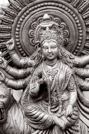 Hindu Goddess with many hands in Black and white photo