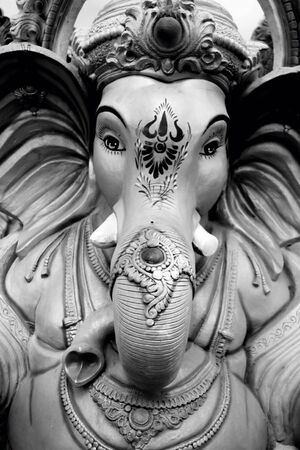 gods: Hindu god lord Ganesha statue in black and white Stock Photo