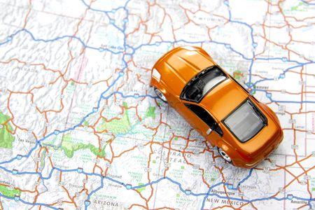 toy car: Orange sports car toy on map