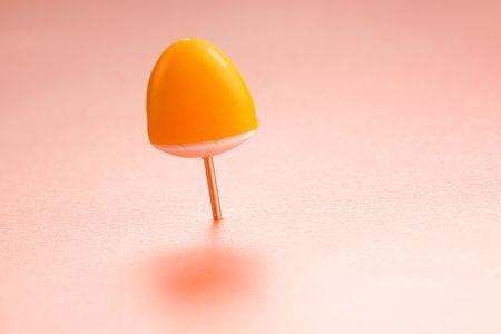 push: Orange push pin