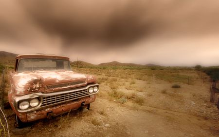 Abandoned car in the desert photo