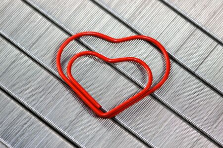 Red  paper clip in heart shape photo