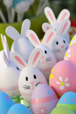 Many colorful designed easter eggs and bunny toys  photo