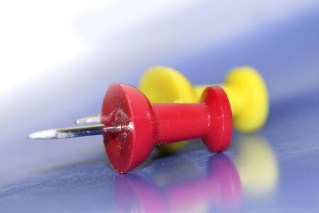 push: Red and yellow push pins