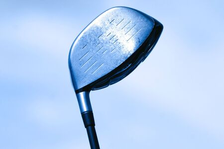 Golf club against sky background in blue color tone
