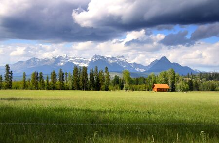 country landscape: Scenic landscape with overcast skies in rural Montana