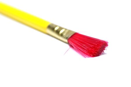 bristles: Yellow paint brush with red bristles on white background Stock Photo