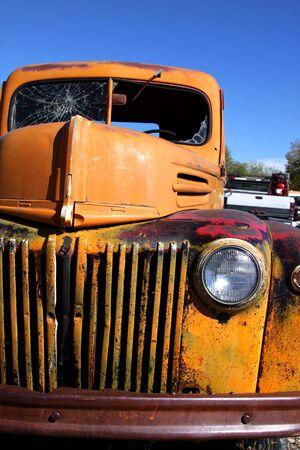 rusty car: Old Rustic yellow pick up close up shot