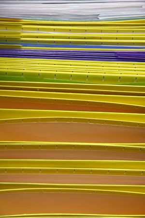 Lot of colorful folders arranged in a row  photo
