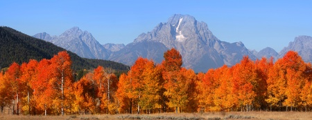 Grand Tetons national mountain range in Autumn time photo