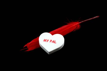 pal: White color heart with Pal text and with red feather