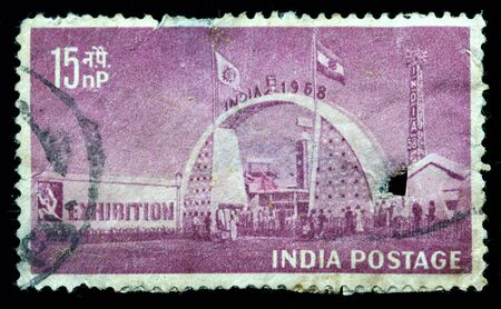 INDIA - CIRCA 1958: A stamp printed in India (present time India) shows Exhibition Gate, New Delhi,, circa 1958 photo