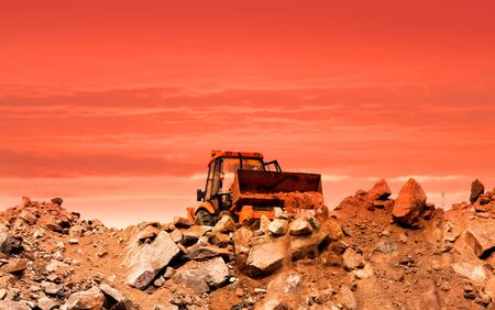 Earth moving equipment at work with evening sky background photo
