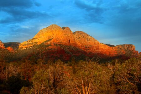sedona: Red rock hill in Sedona Arizona in evening sun light Stock Photo
