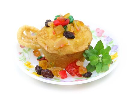 Miniature fruit cake with biscuit in a plate photo