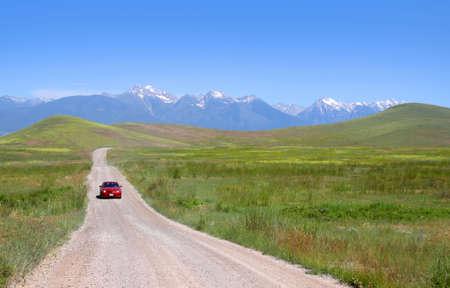 Rural drive through scenic prairie landscape in Montana photo