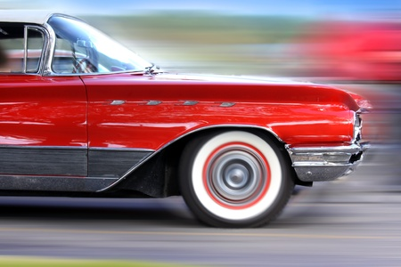 restored: Fast moving classic red car on road