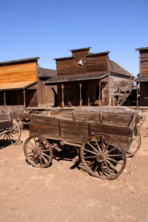 Old carts in a Ghost town near Cody, Wyoming photo