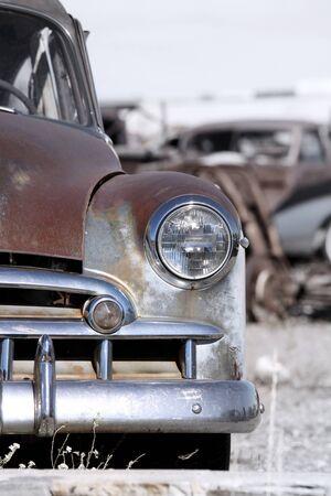 Old rustic cars in a scrap yard  photo