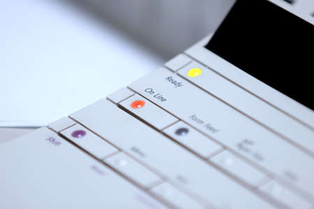 Online button on a fax and scanner machine Stock Photo