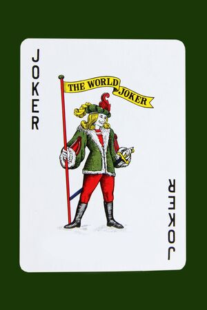 Isolated joker card on dark green background Editorial