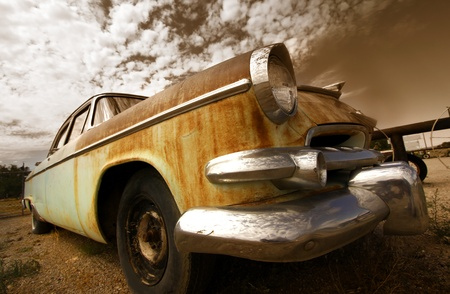 Wide angle shot of rustic car in sepia