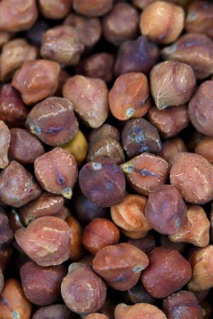 Brown color whole lentil grains with skin photo