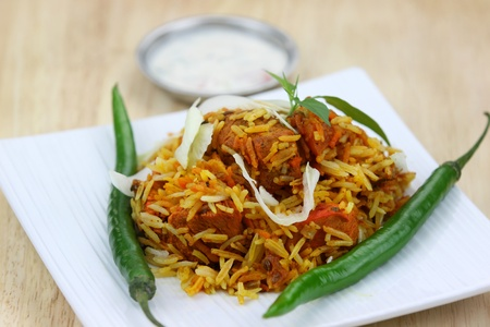 Famous Indian dish chicken biryani made with spices and rice photo