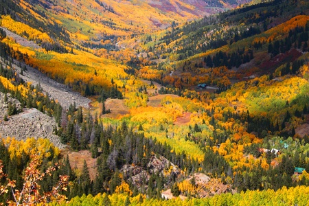 rocky road: Aspen valley in Colorado during Autumn time Stock Photo