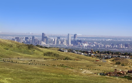 denver skyline with mountains: Denver skyline in Colorado from rocky mountains Stock Photo