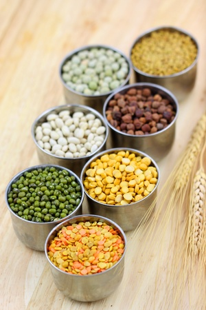 pulses: Raw food grains in small steel cups