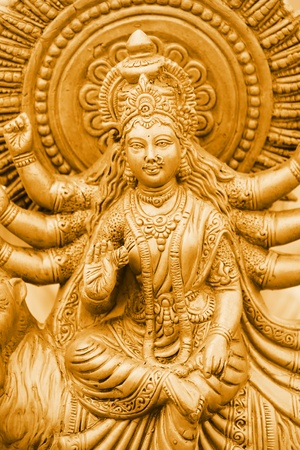 ancient india: Hindu Godess Kalis statue in gold color  Stock Photo