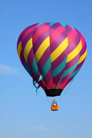 hot air: Single colorful hot air balloon in air Stock Photo